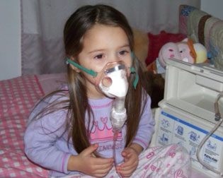 Child using a nebulizer